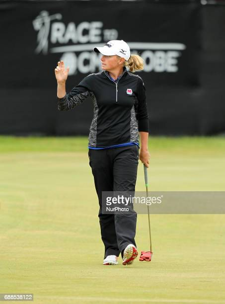 Stacy Lewis of the United States acknowledge the crowd after her birdie shot on the 18th green during the first round of the LPGA Volvik Championship...