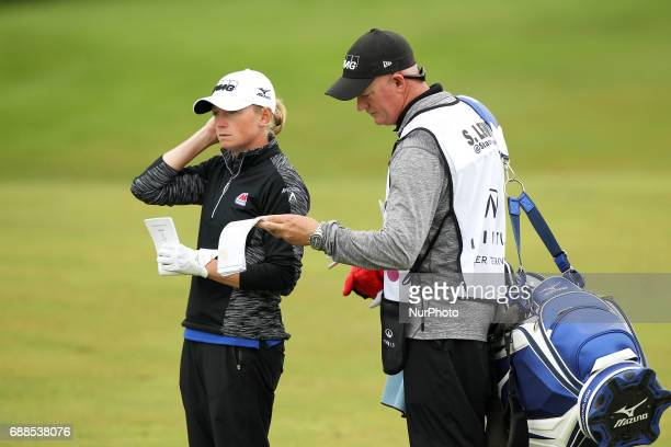 Stacy Lewis of the United States and caddie wait in the fairway of the 18th hole during the first round of the LPGA Volvik Championship at Travis...