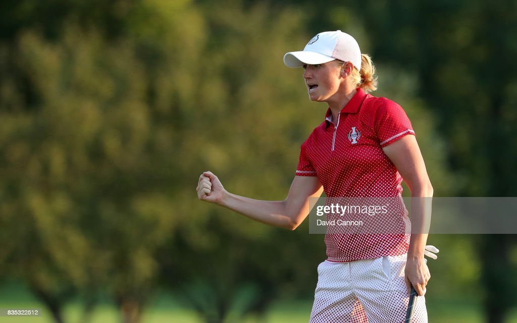 Stacy Lewis of the United States celebrates holing the match winning putt for a birdie on the 17th hole in her match with Gerina Piller against Charley Hull and Georgia Hall of the European Team during the afternoon fourball matches in the 2017 Solheim Cup at Des Moines Golf Coutry Club on August 18, 2017 in West Des Moines, Iowa.