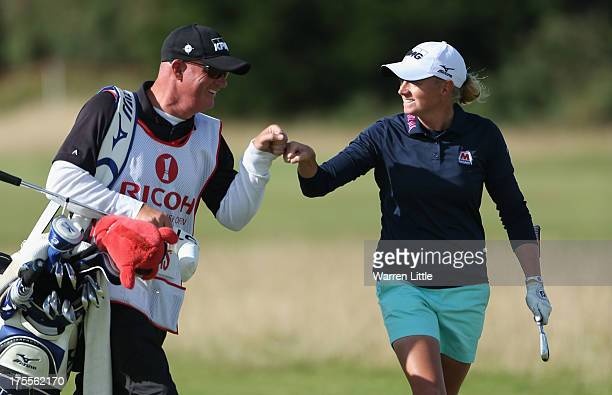Stacy Lewis of the United States celebrates with caddie Travis Wilson on the 17th hole during the final round of the Ricoh Women's British Open at...