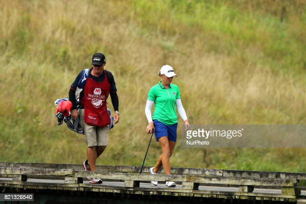 Stacy Lewis of the United States cross the bridge on the way to the second green during the final round of the Marathon LPGA Classic golf tournament...
