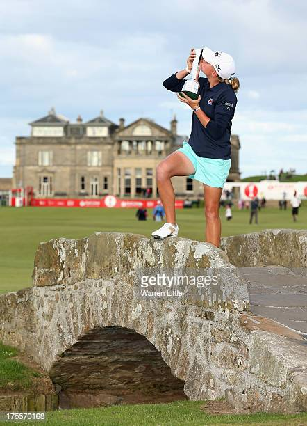 Stacy Lewis of the United States kisses the trophy on the Swilcan Bridge following her victory during the final round of the Ricoh Women's British...