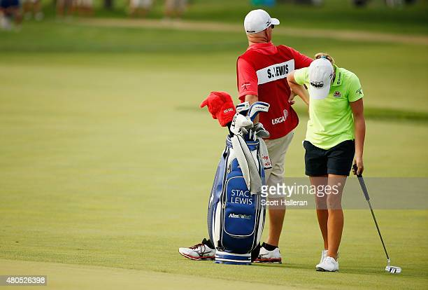 Stacy Lewis of the United States waits with her caddie Travis Wilson on the 18th green during the final round of the US Women's Open at Lancaster...