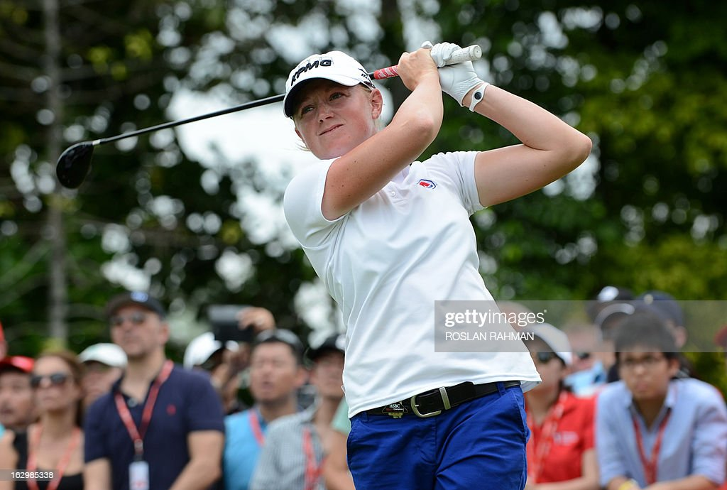 Stacy Lewis of the US hits a shot during the final round of the HSBC Women's Champions LPGA golf tournament at the Serapong Course in Singapore on March 3, 2013. The 1.4 million USD tournament takes place from February 28 to March 3.