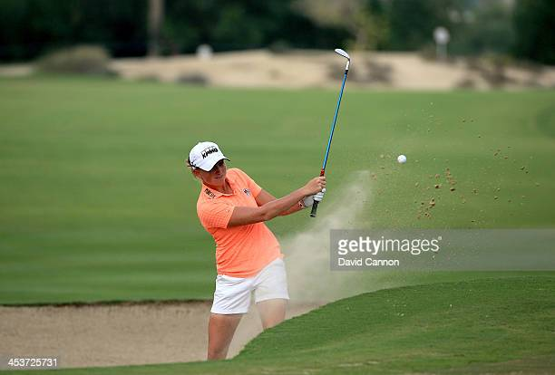 Stacy Lewis of the USA plays her third shot at the par 4 14th hole during the second round of the 2013 Omega Dubai Ladies Masters on the Majilis...