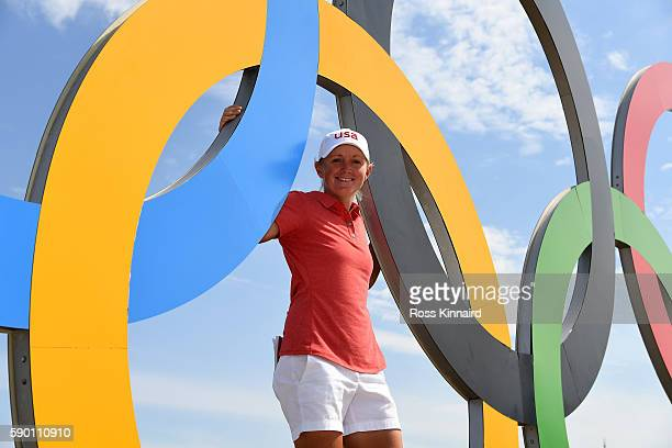 Stacy Lewis of the USA poses with the Olympic Rings during a practice round prior to the Women's Individual Stroke Play golf at the Olympic Golf...