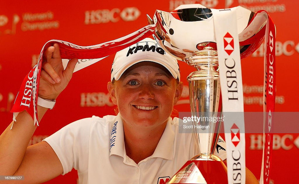 Stacy Lewis of the USA poses with the trophy after winning the HSBC Women's Champions at the Sentosa Golf Club on March 3, 2013 in Singapore, Singapore.