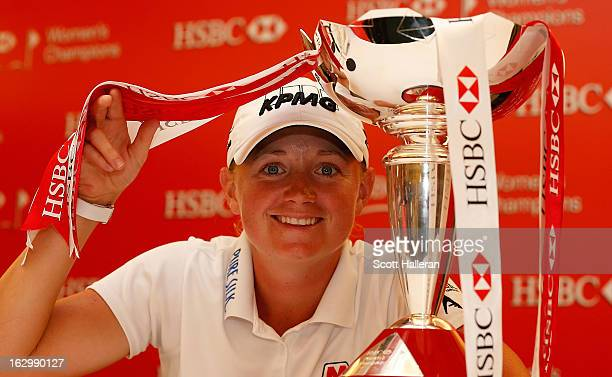 Stacy Lewis of the USA poses with the trophy after winning the HSBC Women's Champions at the Sentosa Golf Club on March 3 2013 in Singapore Singapore