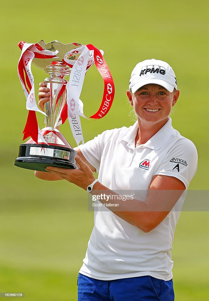 <a gi-track='captionPersonalityLinkClicked' href=/galleries/search?phrase=Stacy+Lewis+-+Golfer&family=editorial&specificpeople=4217318 ng-click='$event.stopPropagation()'>Stacy Lewis</a> of the USA poses with the trophy after winning the HSBC Women's Champions at the Sentosa Golf Club on March 3, 2013 in Singapore, Singapore.