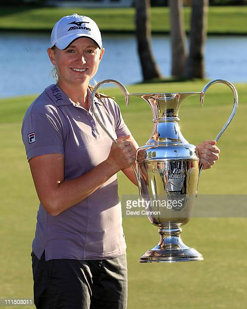 Stacy Lewis of the USA proudly holds the trophy after the final round of the 2011 Kraft Nabisco Championship on the Dinah Shore Championship Course...