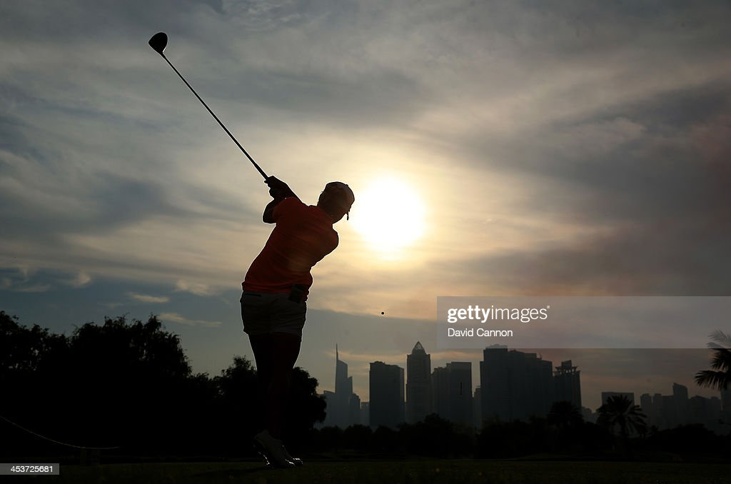 Stacy Lewis of the USA tees off agaist the evening skies at the 14th hole during the second round of the 2013 Omega Dubai Ladies Masters on the Majilis Course at the Emirates Golf Club on December 5, 2013 in Dubai, United Arab Emirates.