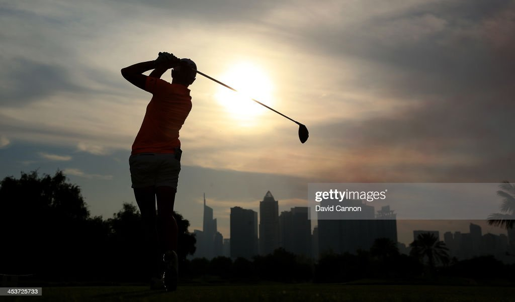 Stacy Lewis of the USA tees off agaist the evening skies at the 14th hole during the second round of the 2013 Omega Dubai Ladies Masters on the...