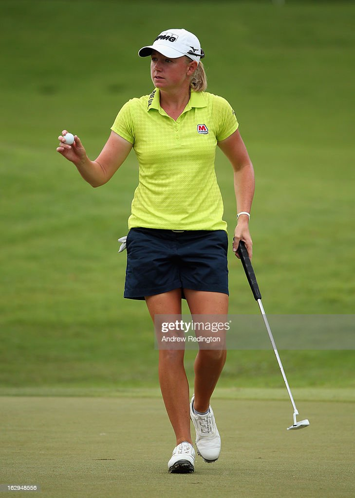 <a gi-track='captionPersonalityLinkClicked' href=/galleries/search?phrase=Stacy+Lewis+-+Golfer&family=editorial&specificpeople=4217318 ng-click='$event.stopPropagation()'>Stacy Lewis</a> of the USA waves to the crowd on the 17th hole during the third round of the HSBC Women's Champions at the Sentosa Golf Club on March 2, 2013 in Singapore, Singapore.