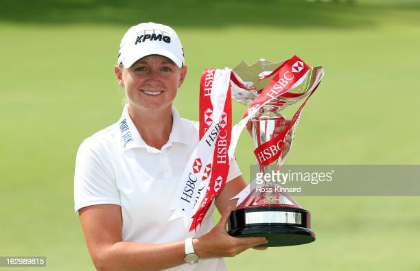 Stacy Lewis of the USA with the winners trophy after the final round of the HSBC Women's Champions at the Sentosa Golf Club on March 3 2013 in...