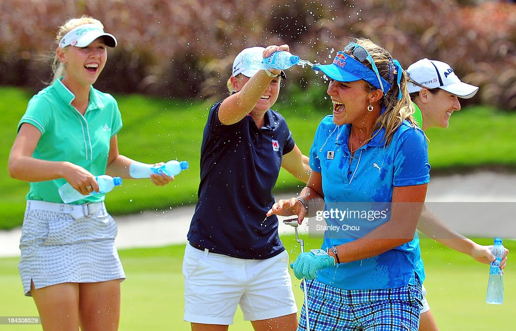 <a gi-track='captionPersonalityLinkClicked' href=/galleries/search?phrase=Stacy+Lewis&family=editorial&specificpeople=4217318 ng-click='$event.stopPropagation()'>Stacy Lewis</a> of USA pours water on Lexi Thompson of USA while <a gi-track='captionPersonalityLinkClicked' href=/galleries/search?phrase=Jessica+Korda&family=editorial&specificpeople=5410628 ng-click='$event.stopPropagation()'>Jessica Korda</a> of USA looks on after Lexi Thompson won by 19 under 265 on the 18th hole during day four of the Sime Darby LPGA at Kuala Lumpur Golf & Country Club on October 13, 2013 in Kuala Lumpur, Malaysia.