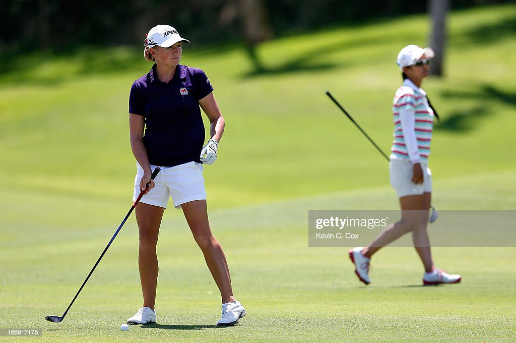 Stacy Lewis prepares for her second shot on the fifth hole after Ai Miyazato of Japan hit her second shot during the second round of the LPGA LOTTE Championship Presented by J Golf at the Ko Olina Golf Club on April 18, 2013 in Kapolei, Hawaii.