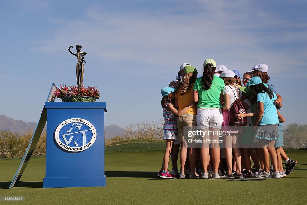 <a gi-track='captionPersonalityLinkClicked' href=/galleries/search?phrase=Stacy+Lewis&family=editorial&specificpeople=4217318 ng-click='$event.stopPropagation()'>Stacy Lewis</a> receives a group hug from the kids from 'LPGA-USGA Girls Golf' after winning the the RR Donnelley LPGA Founders Cup at Wildfire Golf Club on March 17, 2013 in Phoenix, Arizona.