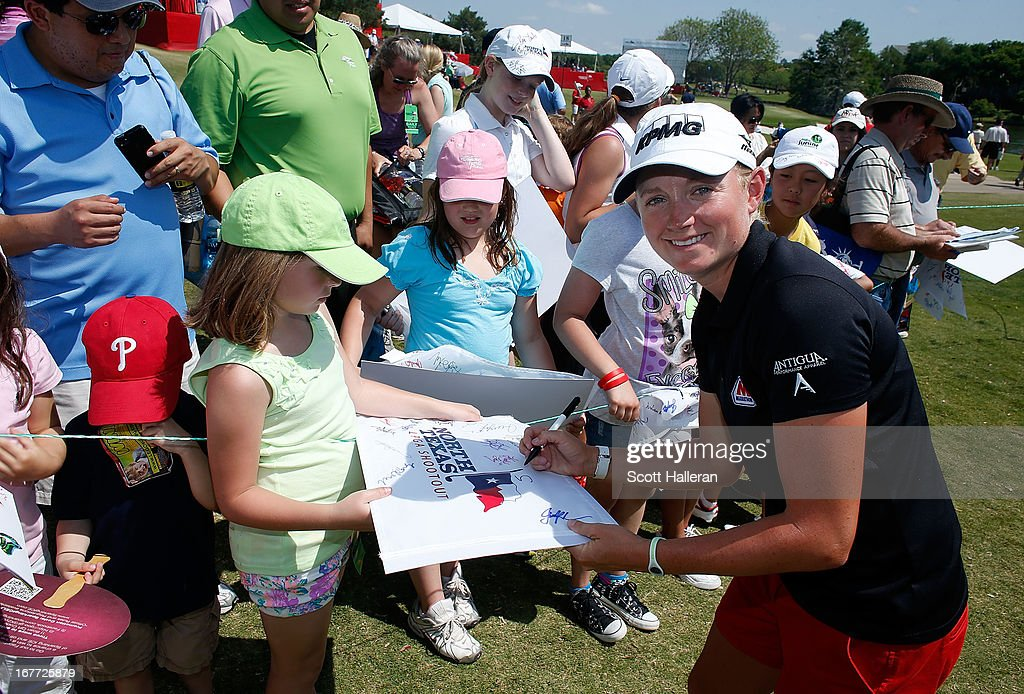 Stacy Lewis signs autographs for fans during the final round of the 2013 North Texas LPGA Shootout at the Las Colinas Counrty Club on April 28, 2013 in Irving, Texas.