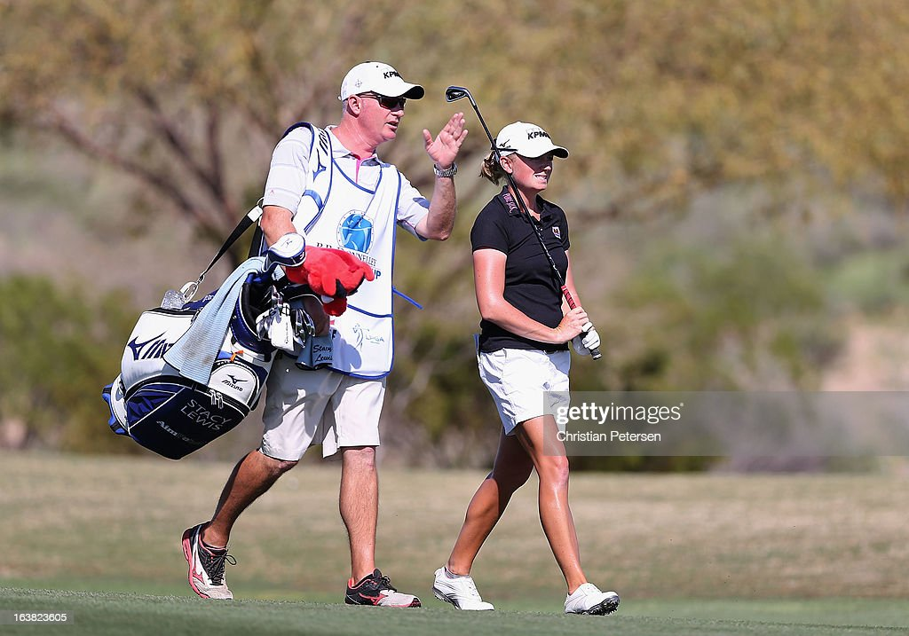 <a gi-track='captionPersonalityLinkClicked' href=/galleries/search?phrase=Stacy+Lewis+-+Golfer&family=editorial&specificpeople=4217318 ng-click='$event.stopPropagation()'>Stacy Lewis</a> (R) walks with her caddie <a gi-track='captionPersonalityLinkClicked' href=/galleries/search?phrase=Travis+Wilson+-+Golf+Caddy&family=editorial&specificpeople=15147345 ng-click='$event.stopPropagation()'>Travis Wilson</a> on the 15th hole during the third round of the RR Donnelley LPGA Founders Cup at Wildfire Golf Club on March 16, 2013 in Phoenix, Arizona.