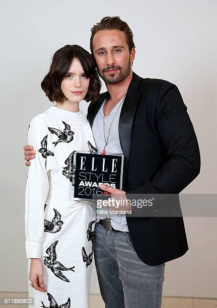 Stacy Martin with Matthias Schoenaerts winner of the Actor of the Year award poses in the winners room at The Elle Style Awards 2016 on February 23...