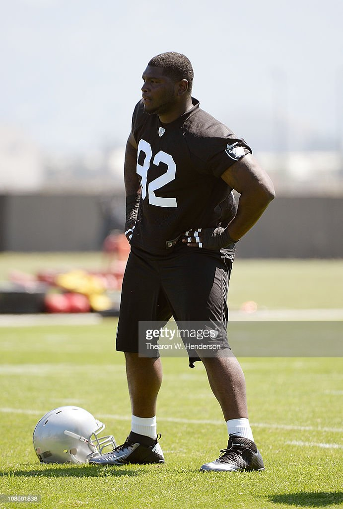 Stacy McGee #92 of the Oakland Raiders stretches during Rookie Mini-Camp on May 11, 2013 in Alameda, California.