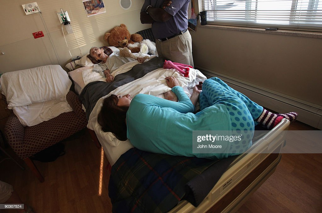 Stacy Roland curls up in bed with her unconscious grandmother Annabelle Martin, 92, during Martin's final hours of life at the Hospice of Saint John on September 2, 2009 in Lakewood, Colorado. Martin had spent almost two and a half years living at the non-profit hospice, which strives to maintain quality of life, manage pain, and offer spirutal guidance for residents in their last stage of life. Government funding for counseling for end of life care has become a contentious issue in the current national debate on health care reform.