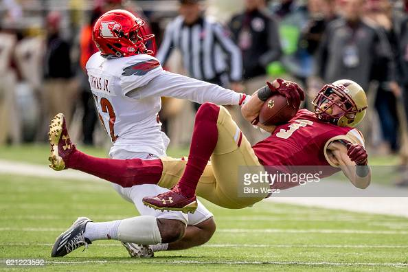 Stacy Thomas of Louisville tackles Michael Walker of Boston College during the second quarter of a game at Alumni Stadium on November 5 2016 in...