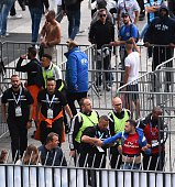 Stade de France's security staff control Marseille's supporters arriving at the entrance of the stadium prior to the the French Cup final football...