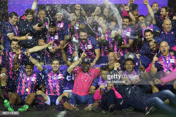 Stade Francais celebrate with the trophy following their team's 2517 victory during the European Rugby Challenge Cup Final between Gloucester and...
