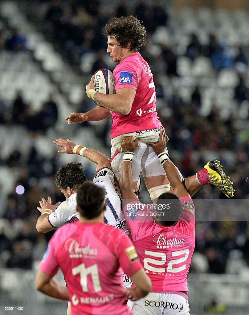 Stade Francais' flanker Sylvain Nicolas (top) grabs the ball in line out during the French Top 14 rugby union match between Bordeaux-Begles and Stade Fran��ais on April 30, 2016 at the Matmut Atlantique Stadium in Bordeaux, western France.
