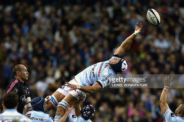Stade Francais' French flanker Antoine Burban looks at RacingMetro's South African flanker Juandre Kruger as he tries to grab the ball in a lineout...
