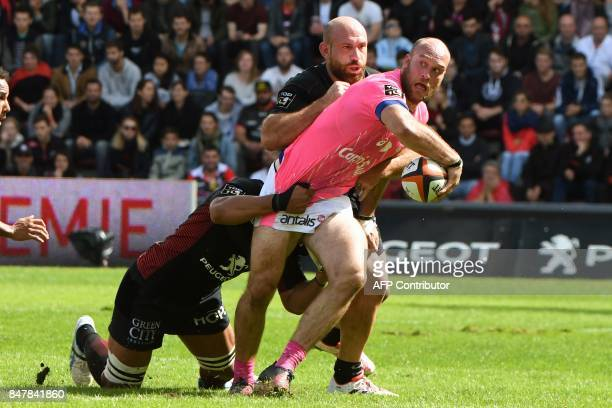 Stade Francais French flanker Antoine Burdan vies with Toulouse's players during the French Top 14 rugby union match Toulouse against Stade Francais...