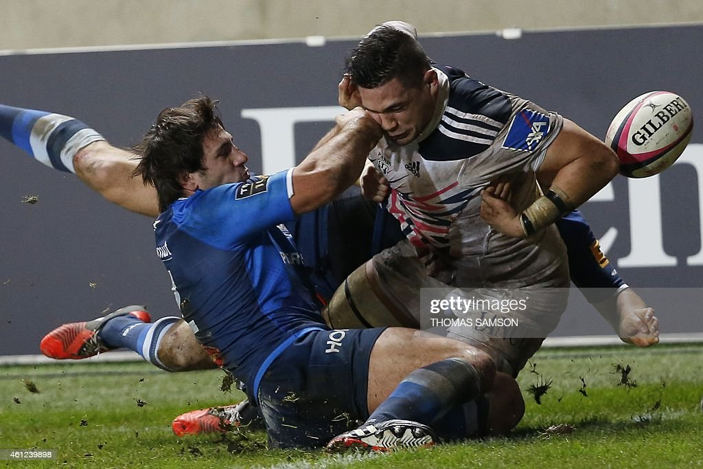 Stade Francais' French number eight <a gi-track='captionPersonalityLinkClicked' href=/galleries/search?phrase=Raphael+Lakafia&family=editorial&specificpeople=7183172 ng-click='$event.stopPropagation()'>Raphael Lakafia</a> (R) and Castres French centre Remi Lamerat (L) fall during the French Top 14 rugby union match between Stade Francais Paris and Castres Olympique on January 9, 2015 at the Jean Bouin stadium in Paris. AFP PHOTO / THOMAS SAMSON