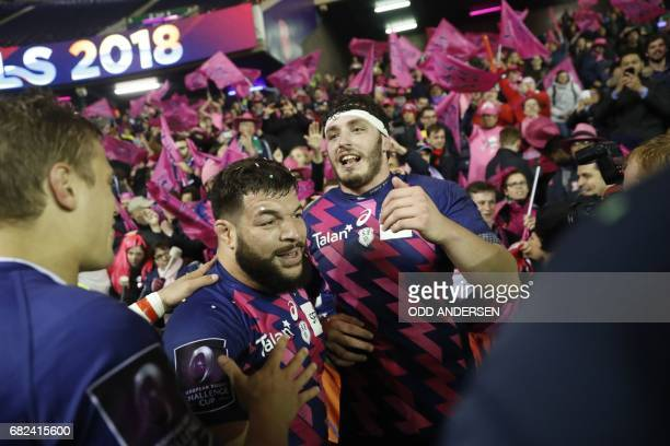 Stade Francais' French prop Rabah Slimani and Stade Francais' French lock Paul Gabrillagues celebrate with supporters after their win in the rugby...