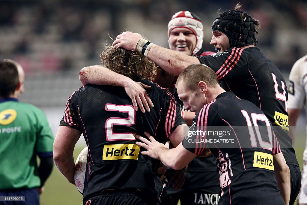 Stade Francais' New Zealander hooker Aled de Malmanche (L) is congratulated by teammates after scoring a try during the French Top14 rugby union match between Stade Francais and Bordeaux-Begles on February 16, 2013 at the Stade Charlety in Paris.