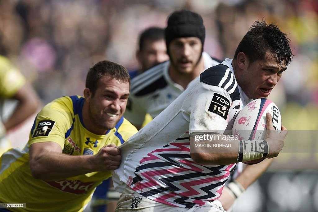 Stade Francais Paris' French flanker <a gi-track='captionPersonalityLinkClicked' href=/galleries/search?phrase=Raphael+Lakafia&family=editorial&specificpeople=7183172 ng-click='$event.stopPropagation()'>Raphael Lakafia</a> (R) tries to escape a tackle by Clermont's French flanker <a gi-track='captionPersonalityLinkClicked' href=/galleries/search?phrase=Alexandre+Lapandry&family=editorial&specificpeople=5678412 ng-click='$event.stopPropagation()'>Alexandre Lapandry</a> (L) during the French Top 14 rugby match between Stade Francais Paris and ASM Clermont Auvergne at Jean Bouin stadium in Paris on March 28, 2015. AFP PHOTO / MARTIN BUREAU