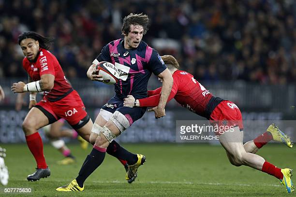 Stade Francais Paris' French Flanker Sylvain Nicolas vies with RC Toulon's Australian fullback James O'Connor during the French Top 14 rugby union...