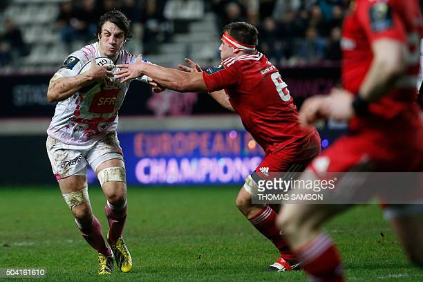 Stade Francais Paris' French Flanker Sylvain Nicolas vies with Munster's South African flanker Cj Stander during the European Champions Cup rugby...