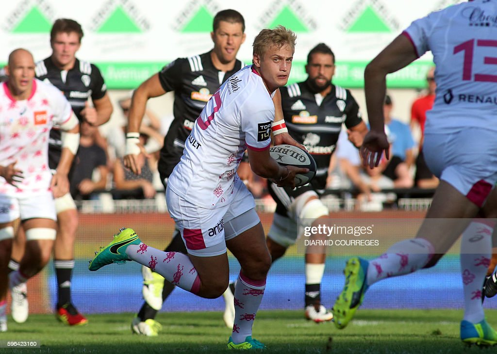Stade Francais Paris' French flyhalf Jules Plisson runs with the ball during the French Top 14 Rugby union match between Brive and Stade Francais on...