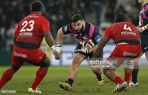 Stade Francais Paris' French prop Rabah Slimani vies with RC Toulon's Manasa Saulo and RC Toulon's French lock Jocelino Suta during the French Top 14...