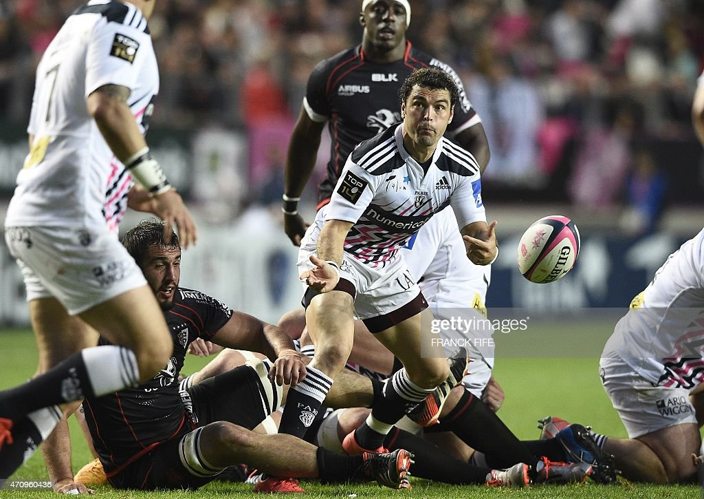 Stade Francais Paris' French scrum-half <a gi-track='captionPersonalityLinkClicked' href=/galleries/search?phrase=Jerome+Fillol&family=editorial&specificpeople=698636 ng-click='$event.stopPropagation()'>Jerome Fillol</a> passes the ball during the French Top 14 rugby match between Stade Francais Paris and Toulouse at Jean Bouin stadium in Paris on April 24, 2015.