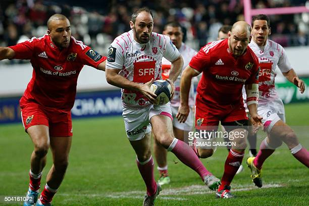 Stade Francais Paris' French scrumhalf Julien Dupuy runs with the ball during the European Champions Cup rugby union match between Stade Francais and...
