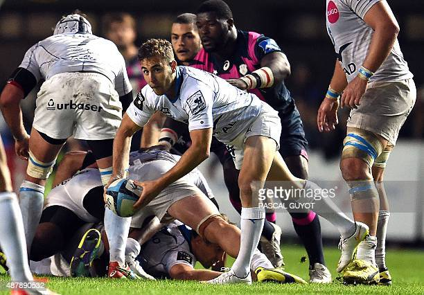 Stade Francais Paris' French scrumhalf Julien Tomas prepares to pass the ball during the French Top 14 rugby union match between Montpellier and...