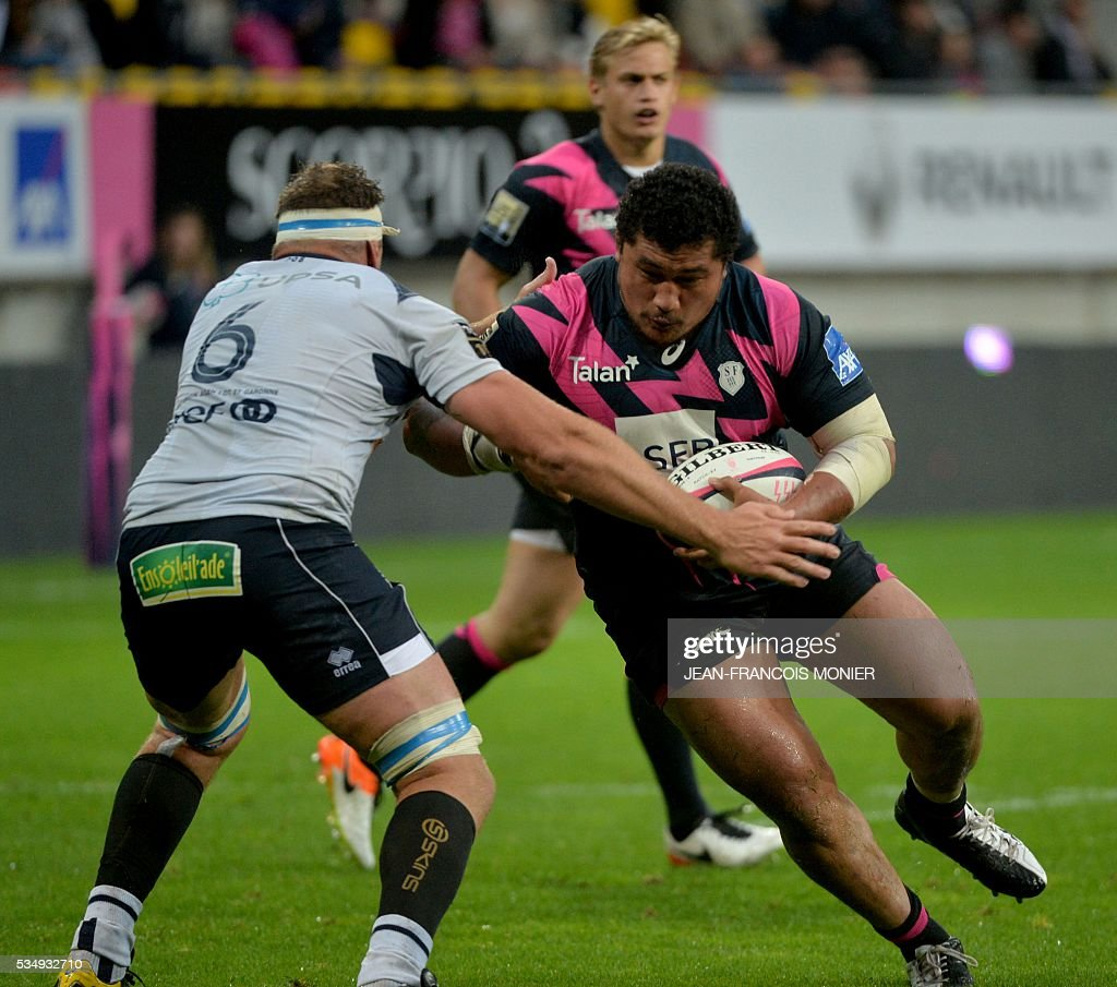 Stade Francais Paris' Samoan prop Sakaria Taufalo (R) is tackled by Agen's South African hooker Marco Kotze during the French Top 14 rugby union match between Agen and Stade Français on May 28, 2016 at the MMArena Stadium in Le Mans, northwestern France.
