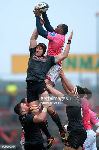 Stade Francais Paris's French flanker Sekou Macalou beats Munster's Australian lock Mark Chisholm in a lineout during the European Rugby Champions...