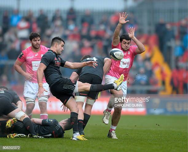 Stade Francais Paris's French hooker Laurent Panis attempts to block as Munster's Irish scrumhalf Conor Murray kicks the ball during the European...