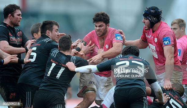 Stade Francais Paris's South African flanker Jonathan Ross attempts to push through the Munster defence during the European Rugby Champions Cup rugby...