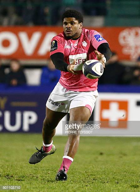 Stade Francais' player Jonathan Danty passes the ball during the European Rugby Champions Cup match between Trevise and Stade Francais Paris at the...