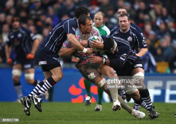 Stade Francais player Sergio Parisse is stopped by Bristol's David Hill and Andrew Blowers during the Heineken Cup Pool 3 match at the Memorial...
