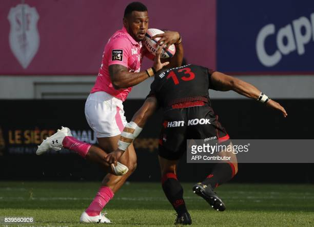Stade Francais's Fijian winger Nayacalevu Waisea is tackled by Lyon's New Zealand centre Rudi Wulf during the French Top 14 rugby union match between...